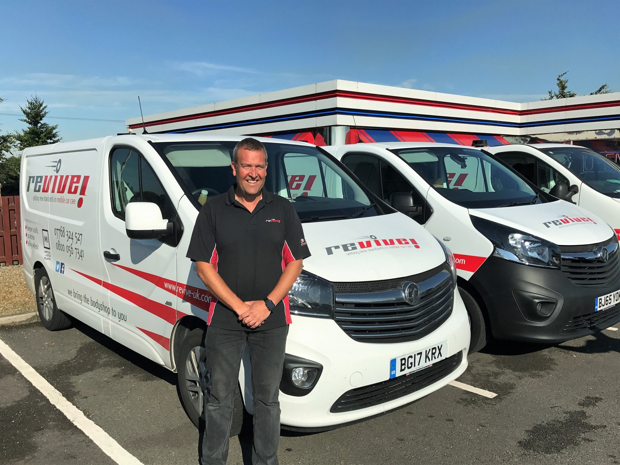 Russell Hudson with his fleet of vans (002)